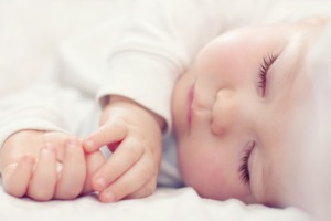 Beautiful sleeping baby conceived with surrogacy